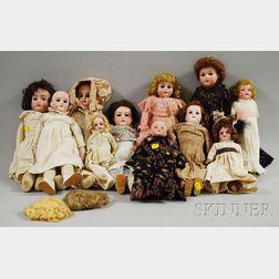 Eleven Small German Bisque Head Dolls