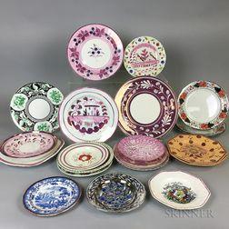 Twenty-six Lustre and Lustre-decorated Ceramic Plates.     Estimate $20-200