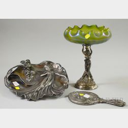 Art Nouveau Silver-plated Cast Metal Figural and Iridescent Green Glass Compote,   Silver-plated Hand Mirror, and Figural Tray