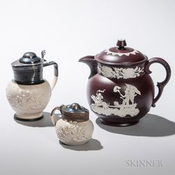Three Stoneware Pitchers