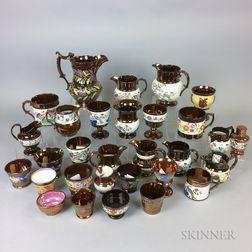 Thirty Pieces of Copper Lustre Ceramic Tableware.     Estimate $20-200