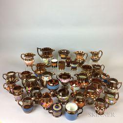 Thirty-six Pieces of Copper Lustre Ceramic Tableware.     Estimate $20-200