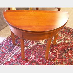 Chippendale Carved Cherry and Mahogany Veneer Demilune Card Table.