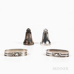 Two Georg Jensen Sterling Silver Salt Shakers and a Pair of Georg Jensen Sterling Silver Napkin Rings