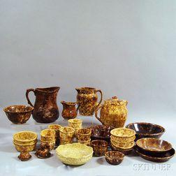 Thirty-one Pieces of Rockingham-glazed Pottery