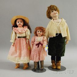 Two Bisque Dolls and a Metal Shoulder Head Doll