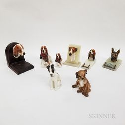 Eight Royal Doulton Ceramic Dog Items