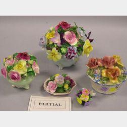 Nine Porcelain and Ceramic Floral Basket Figural Groups.