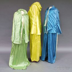 Three Leon Bakst Satin and Rayon Hooded Capes
