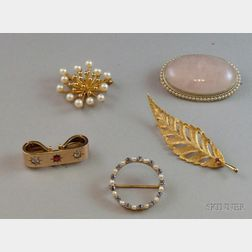 Four Assorted Gold Brooches and a Gold and Gemstone Enhancer
