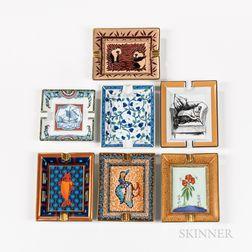 Six Hermes Porcelain Ashtrays and a Maebata Ashtray.     Estimate $400-600