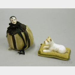 Two Art Deco Porcelain and Cloth Figural Pincushions