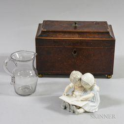 Georgian Inlaid Burl Veneer Tea Caddy, a Blown Colorless Glass Jug, and a B & G Figure.     Estimate $150-200