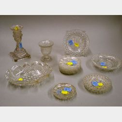 Fourteen Pieces of Sandwich Colorless Pressed Lacy Glass Tableware