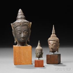 Three Metal Buddha Heads
