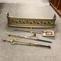 Pierced Brass Fireplace Fender, a Poker, a Shovel, and a Pair of Tongs.     Estimate $200-400