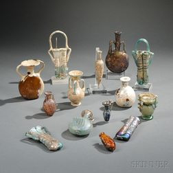 Fourteen Roman-style Glass Vessels