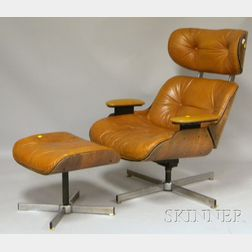 Eames-style Naugahyde Upholstered Walnut Laminated Lounge Chair and Ottoman.     Estimate $300-500