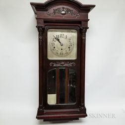 New Haven Oak Wall Clock and a German Mahogany Wall Clock