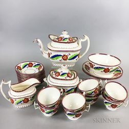Twenty-nine-piece Pink Lustre Ceramic Tea Set.     Estimate $150-250