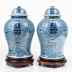 Near Pair of Blue and White Jars and Covers