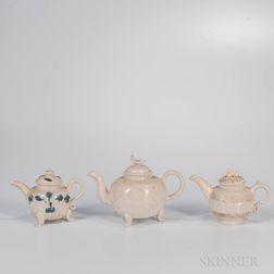 Three Staffordshire Salt-glazed Stoneware Teapots and Covers