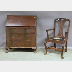 Chippendale-style Mahogany Slant-lid Serpentine Desk and an Armchair.