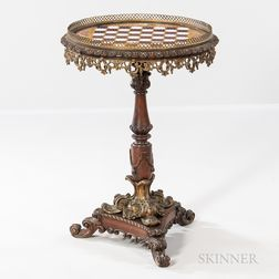 Porcelain, Brass, and Carved Hardwood Games Table