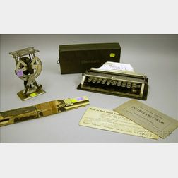 Bennett Portable Typewriter, a Metal Postal Scale, and a Keuffel & Esser Slide Rule.