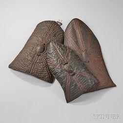 Three African Embossed Hide Shields