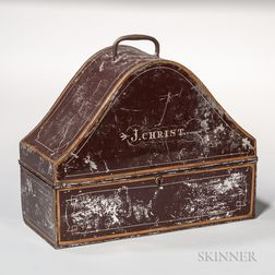 """Red/Brown-painted Tin """"J. CHRIST."""" Hatbox"""