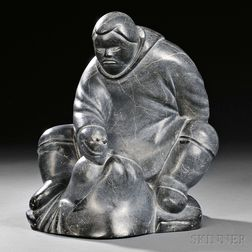 Inuit Sculpture of a Man and a Stylized Walrus