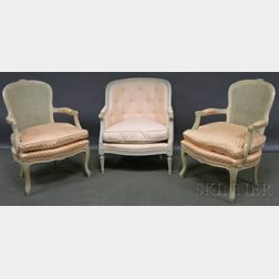 Pair of Louis XVI-style Upholstered Painted Carved Wood Fauteuils and a Bergere.