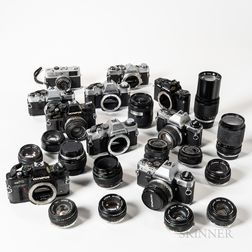 Group of 35mm Olympus Cameras and Lenses.