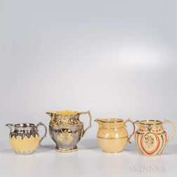Four Staffordshire Yellow-glazed Molded Jugs
