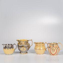 Four Staffordshire Yellow-glazed Molded Jugs