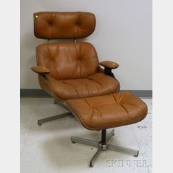 Eames-style Naugahyde Upholstered Laminated Wood Lounge Chair and Ottoman.