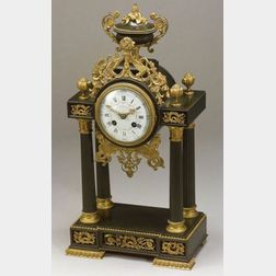 French Empire-style Parcel Gilt and Patinated Bronze Mantel Clock