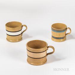 Three Slip-decorated Yellowware Mugs