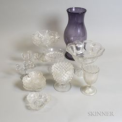 Eleven Pieces of Colorless Pressed Glass and an Amethyst Glass Hurricane Shade