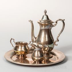 Cartier Three-piece Sterling Silver Tea Set and a Silver-plated Tray