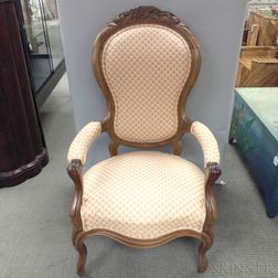 Rococo Revival Carved and Upholstered Walnut Armchair