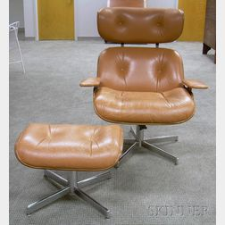 Eames-style Beige Leather Upholstered Walnut Veneer Lounge Chair and Ottoman.