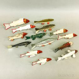 Fourteen Painted Wood and Metal Fish Decoys