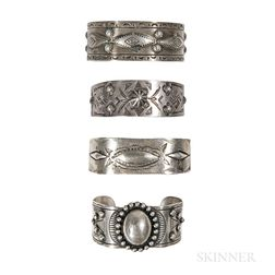 Four Navajo and Mexican Silver Band Bracelets