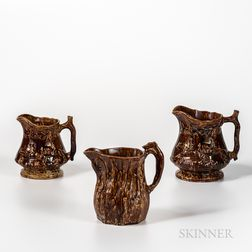 Three Rockingham-glazed Hound-handle Pitchers