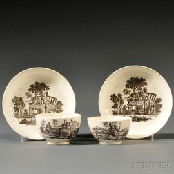Two Staffordshire Cream-colored Earthenware Tea Bowls and Saucers