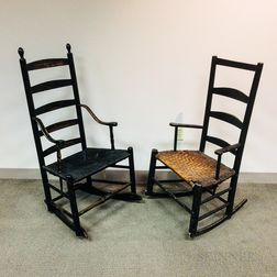 Two Black-painted Slat-back Armed Rocking Chairs.
