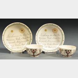 Two Miniature Hand-painted Creamware Tea Bowls and Saucers