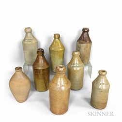 Seven Stoneware Bottles and a Flask